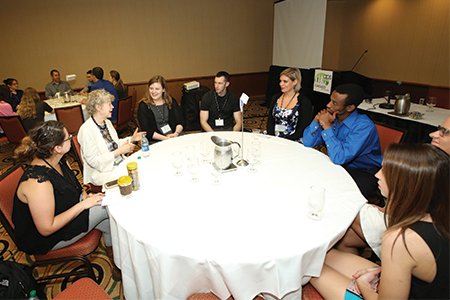 "APS Past President Susan T. Fiske chats with students during the annual ""Champions of Psychological Science"" event."