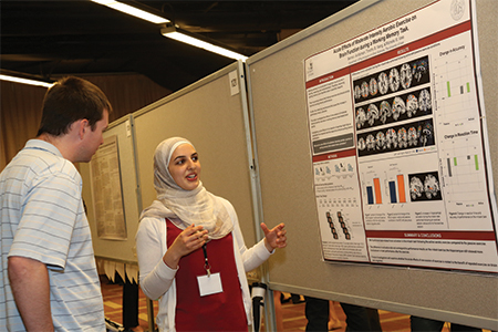 Seima I. Al-Momani presents her poster on the effects of aerobic exercise on brain function during a task that measures working memory. More than 2,700 posters were accepted for the convention.