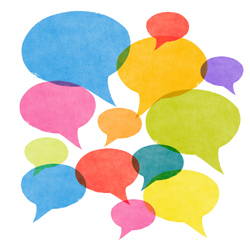 A set of abstract watercolor textured speech bubbles in various sizes and colors all overlapping symbolizing gossip, social media networking and conversation.