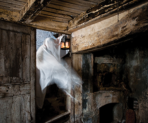 This is a photo of a ghost passing through the door in a old building.