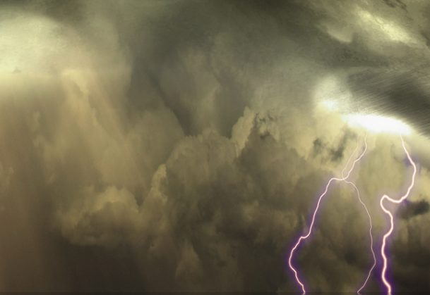This is a picture of an ominous sky with bolts of lightning.
