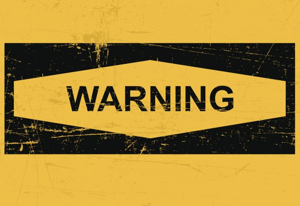 Warning sign banner on a yellow background