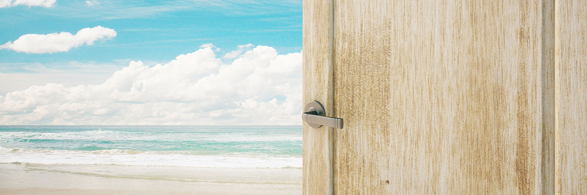 This is a photo of a door opening to a beach.
