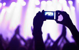 This is a photo of someone taking a cell phone photo of a band performing