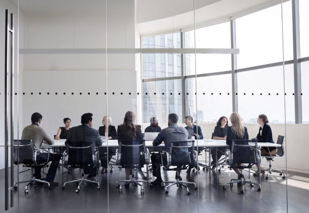 This is a photo of colleagues at business meeting in conference room