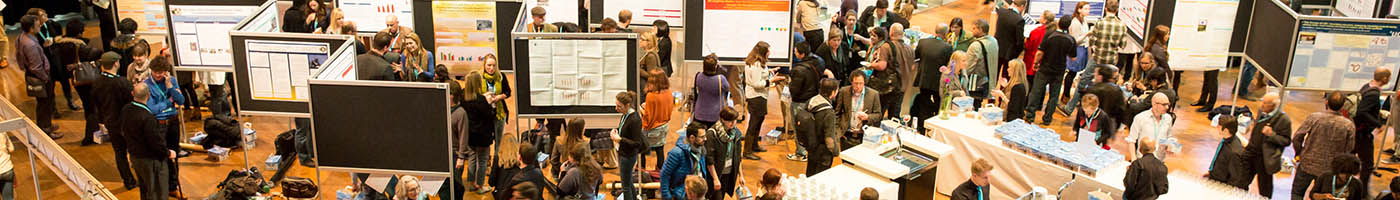 Convention Archive featured image of a poster session in full swing.