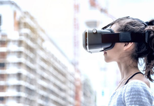 This is a photo of a young woman wearing a virtual-reality headset