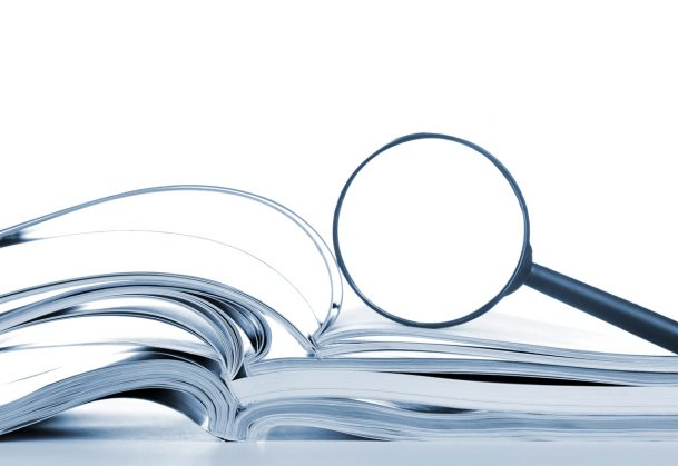 This is a photo of a magnifying glass on top of open books