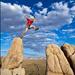 Climber jumping across gap