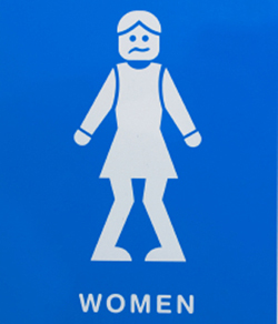 This is a photo of a bathroom sign featuring a woman who urgently has to go.