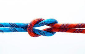 Rope with reef knot isolated on white background.