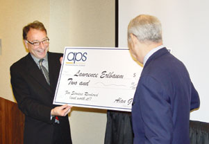 APS Executive Director Alan Kraut handling Larry Erlbaum a much deserved check for his years of service to APS.
