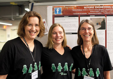 """This family research team – sisters Karen Freberg, Kristin Graham, and mother Laura Freberg – enjoy """"dressing"""" for their poster presentations each year at APS Conventions. Last year, they wore Slytherin (of Harry Potter fame) shirts for their study of CEOs and psychopaths, which they referred to as the """"Snakes in Suits"""" study. This year, they chose shirts with a military theme for their generals study, and marching across those shirts were formidable Lego soldiers. What's in store for next year?"""