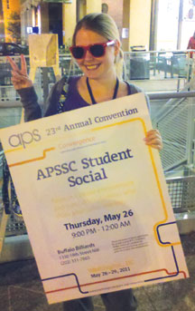 Nearly 300 APS Student Affiliates attended the APSSC Student Social. Darcey Sims holds the sign outside Buffalo Billiards.