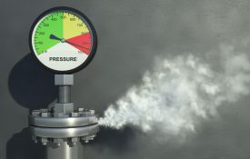 Gas or steam leaking from an industrial pressure gauge