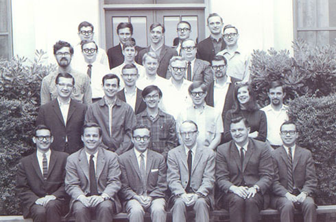 "<p align=""left"">A photo of Estes (fourth from left in the first row) with other Members of the Institute for Mathematical Studies in the Social Sciences at Stanford in 1967. First row: Lester Hyman, Richard Atkinson, Ed Crothers, William Estes, Gordon Bower, Harley Bernbach Second row: Unknown, Bill Mahler, Richard Shiffrin, Steve Link, Elizabeth Loftus, George Wolford Third row: Gordon Allen, David Tieman, John Holmgren, Bill Thompson, David Rumelhart Fourth row: Ken Wexler, Rich Freund, John Brelsford, Leo Keller Fifth row: Mike Clark, David Wessel, Peter Shaw, Don Horst, Dewey Rundus. Members not pictured include Pat Suppes, Guy Groen, Bob Bjork, Dave Wessel, Gary Olson, Bill Batchelder, Hal Taylor, Joe Young and Jim Townsend.</p>"
