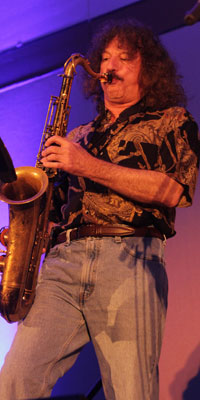 APS Past President Robert W. Levenson blows the audience away with a wailing sax solo.