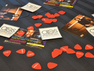 Concert goers get a chance to bring the music home with guitar picks from APS and Worth Publishers.