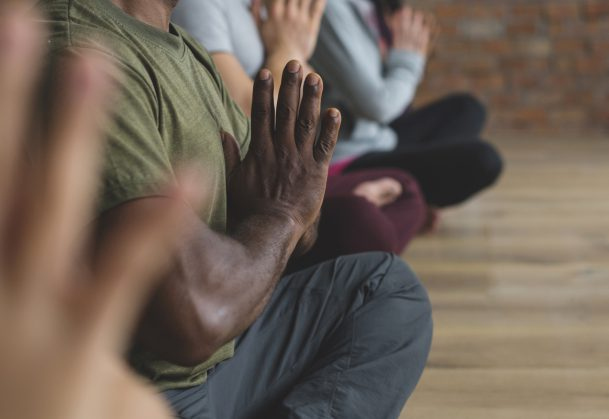 A diverse group of people in a yoga class