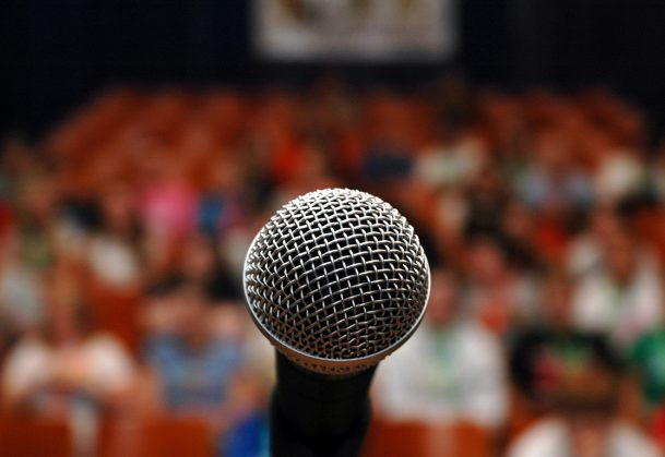 A microphone in front of an audience