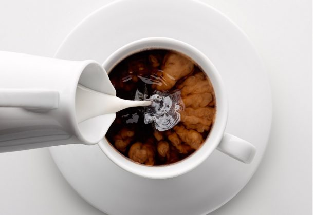 This is a photo of milk being poured into coffee