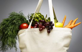 Shopping bag with fresh vegetables, close-up