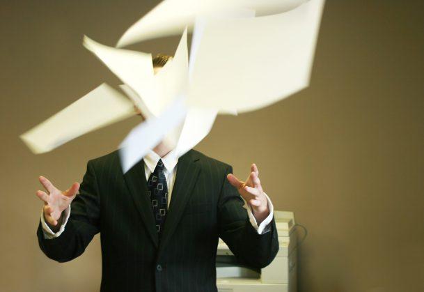 man throwing paper