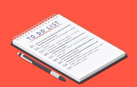 To do list with checklist and pen next to the notepad