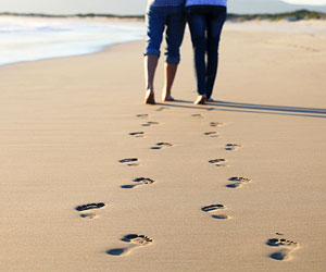 This is a photo of a couple's footsteps on a beach.