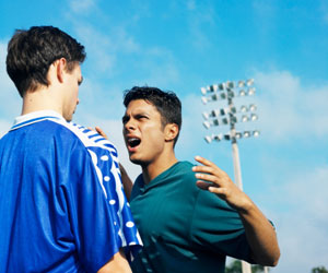 This is a photo of one soccer player yelling at another player.