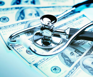 This is a picture of a stethoscope lying on top of hundred dollar bills.