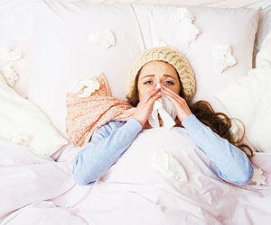 This is a photo of a woman sick in bed.