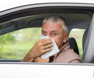 This is a picture of a man blowing into a tissue.