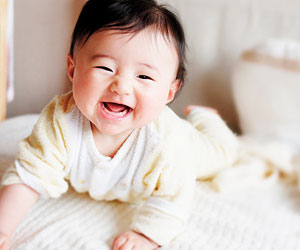 This is a photo of a smiling infant.
