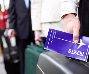 This is a photo of a person holding a plane ticket.