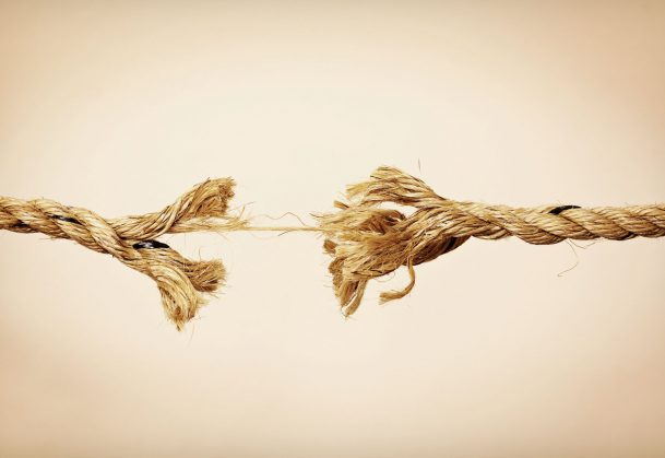This is a photo of a fraying rope that is about to break.