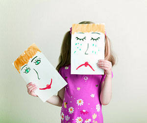 This is a photo of a girl holding papers with different emotional expressions.