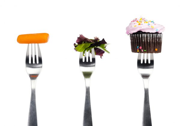 This is a photo showing forks with different food options