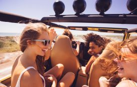 Young women laughing in the car together