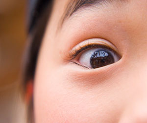 This is a close-up image of a girl's eye.