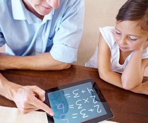 This is a photo of a father helping a daughter with math.