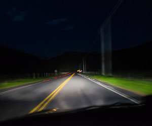 This is a photo of the view from a car at nighttime.