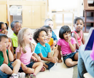 This is a photo of preschool children listening to a story.