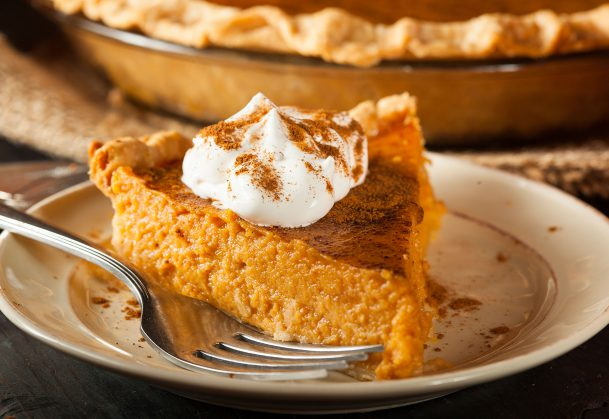 This is a photo of a slice of pumpkin pie.