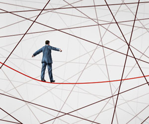 This is an illustration of a man walking a tightrope.