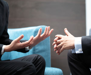 This is a photo of a person gesturing to another person.
