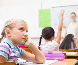 This is a photo of a young female student staring into space.