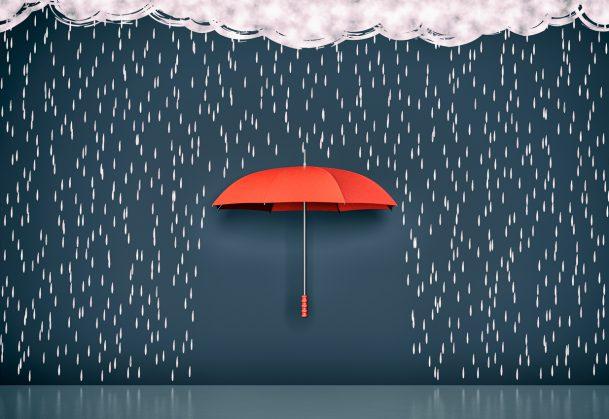 Drawing of dark clouds, rain and one umbrella