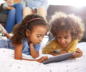 This is a photo of children looking at a tablet.