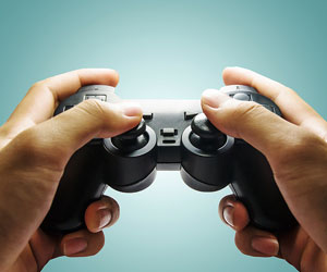 This is a photo of a pair of hands holding a video game controller.